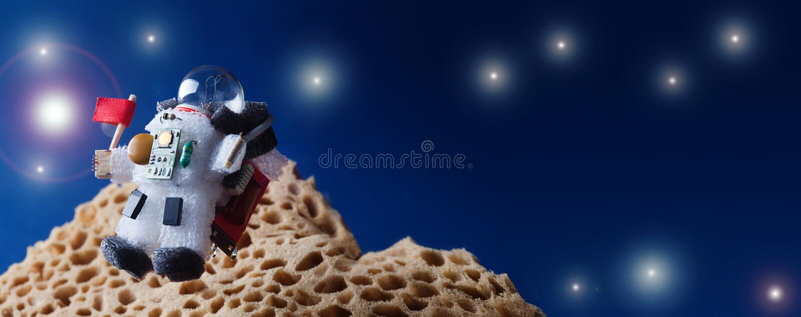 Flying cosmonaut spaceman with red flag. cosmos galactic exploration concept. copy space. Light bulb character dressed stock photos