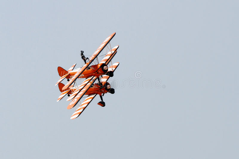 Flying display and aerobatic show of The Breitling Wingwalkers stock images