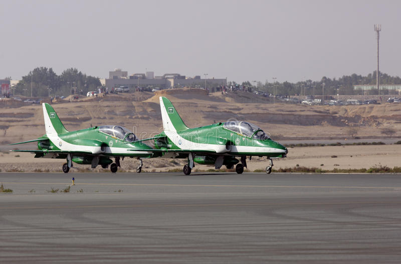 Flying display and aerobatic show of Saudi Hawks display team stock photo