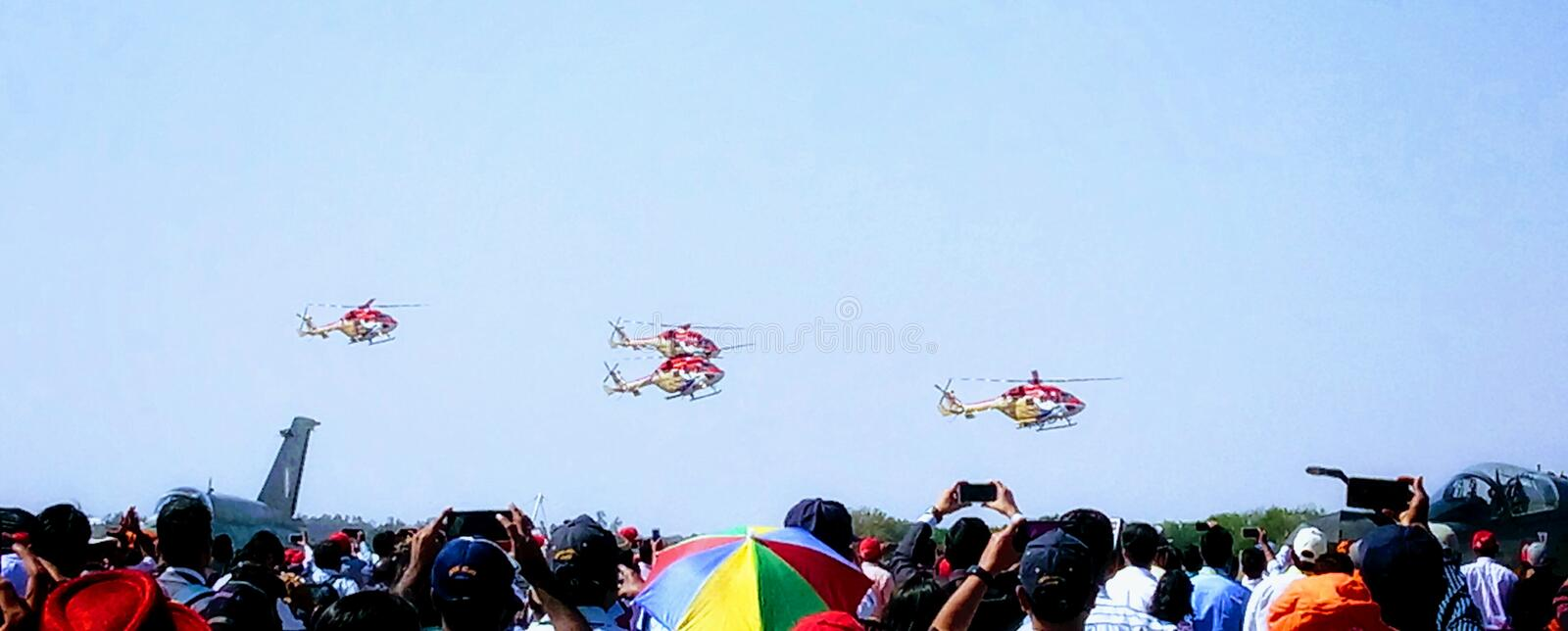 Flying display of Sarang helicopters, Bangalore royalty free stock photography