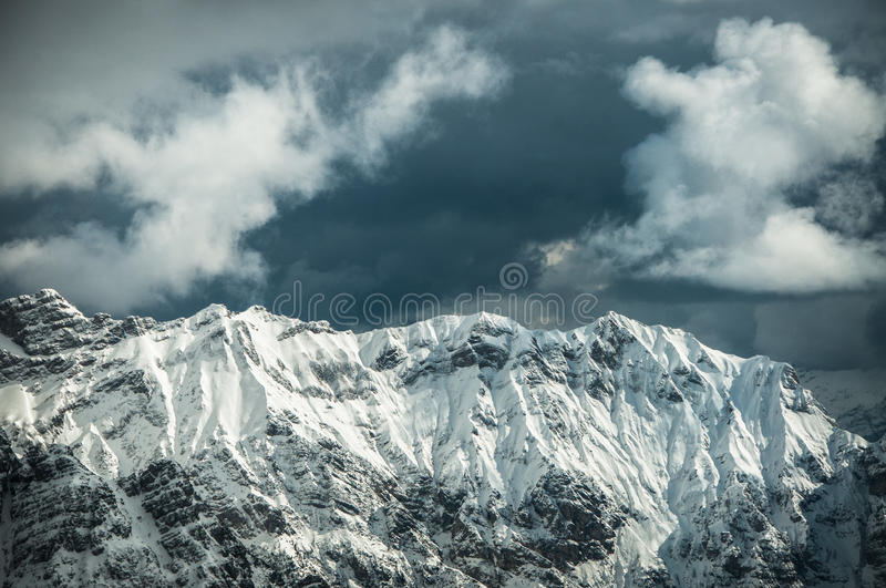 Flying in Dolomites. Flying in a February cloudy day in the Dolomites area stock photography