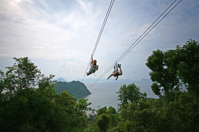 Flying down a zip line stock photo