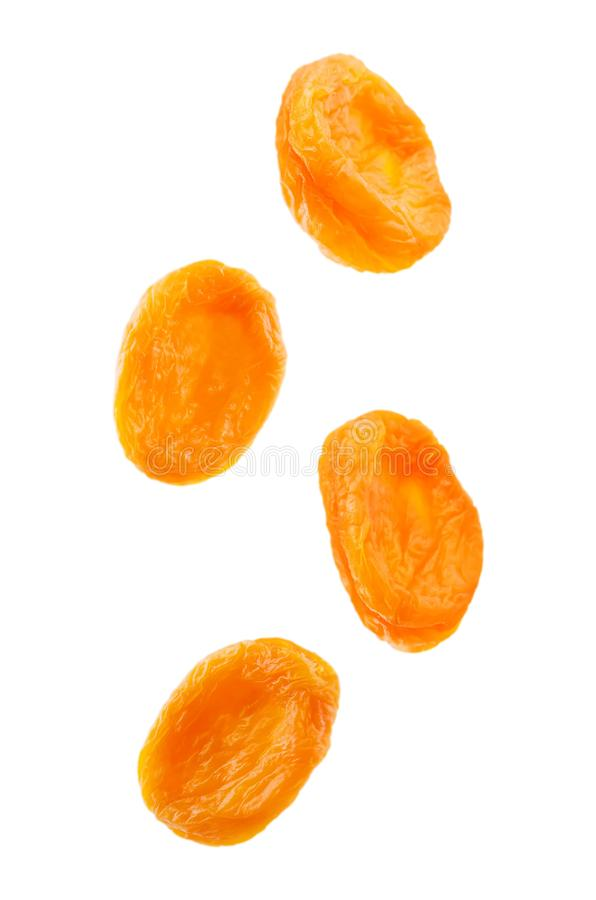 Flying dried apricots isolated stock photo