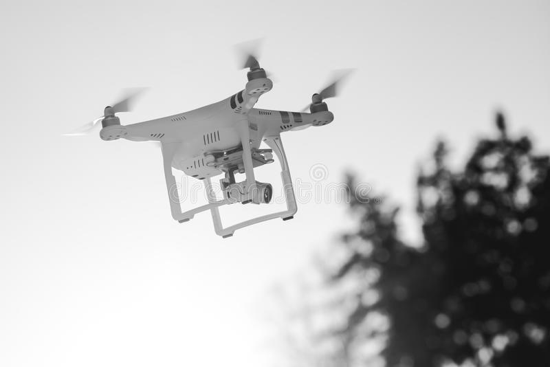 Flying drone with camera stock photos