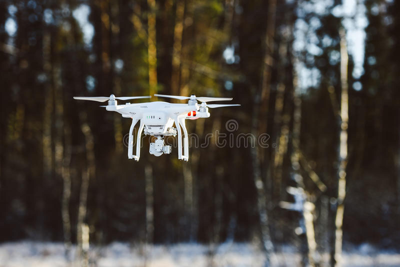 Flying drone with camera, winter scene royalty free stock photos