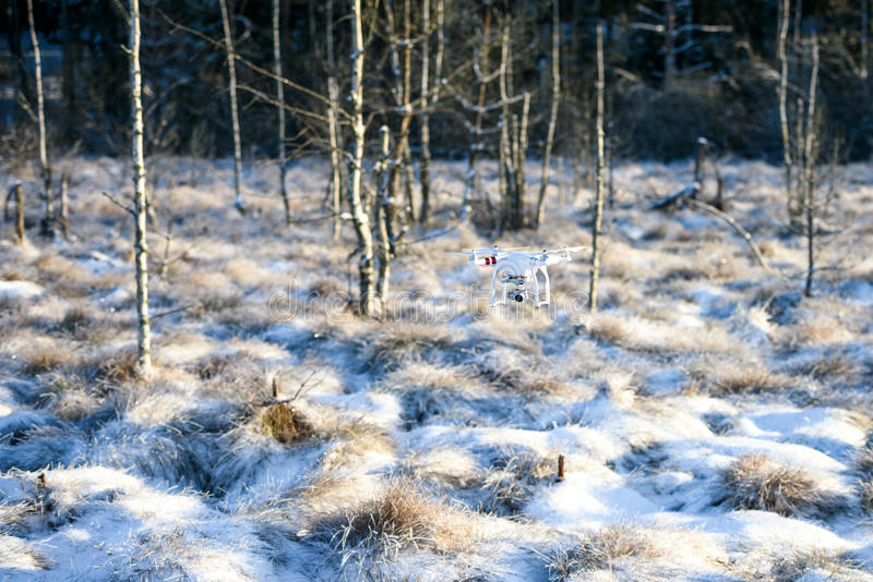 Flying drone with camera, winter scene stock images