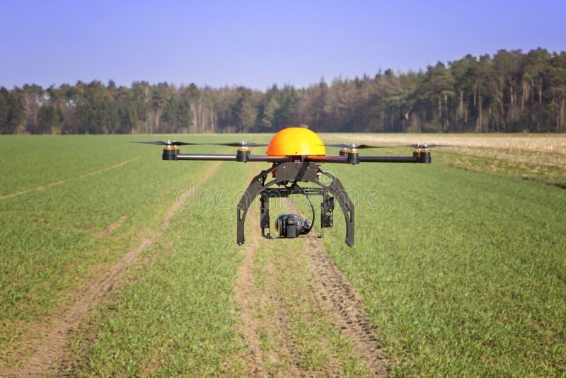 Drone. Flying drone in a field