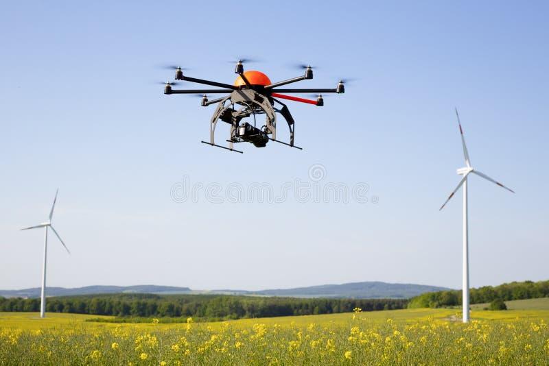 Flying drone in field. Field in Germany