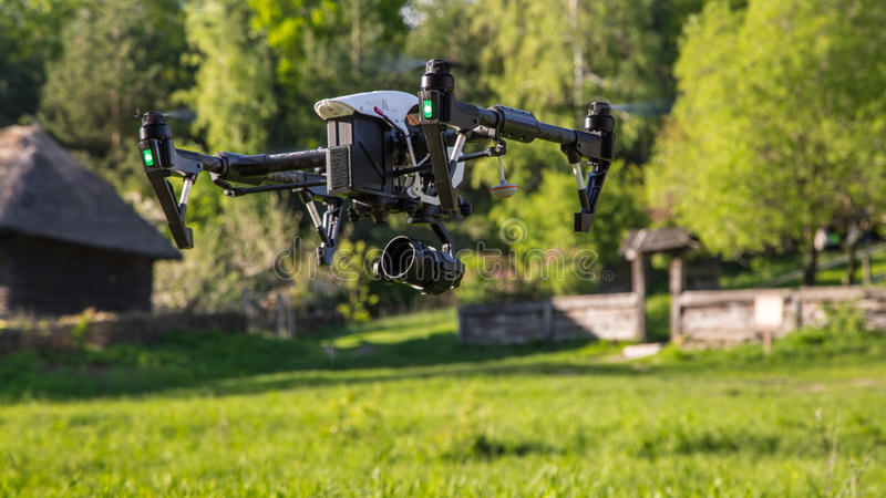 Flying drone is filming in the countryside royalty free stock images
