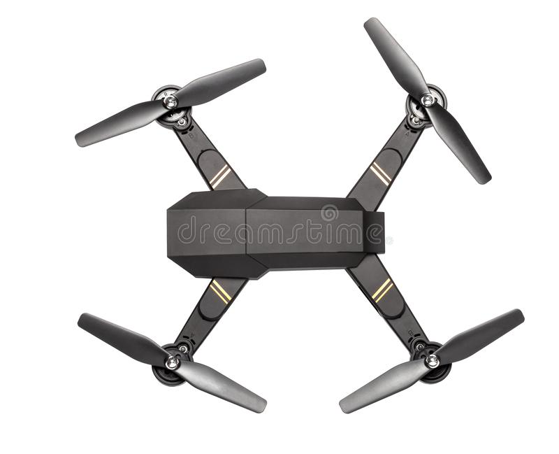 Flying drone with four propellers and  camera for shooting video and photos. Black drone top view isolated on white background stock photography