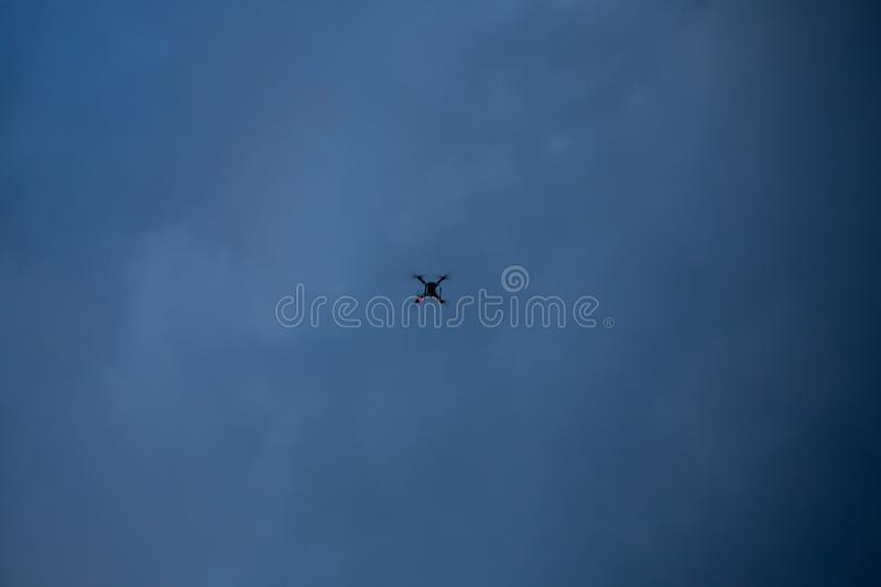 Flying drone over sea and cloud sky stock image