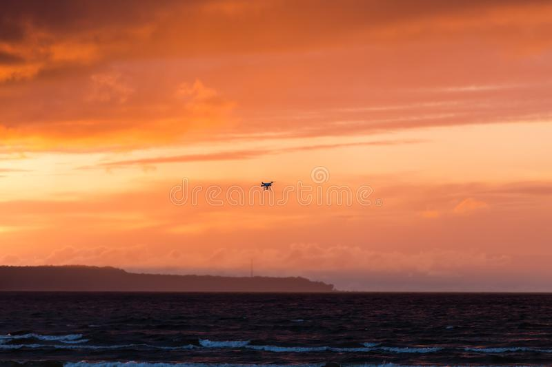 Flying drone over sea and cloud sky royalty free stock photos