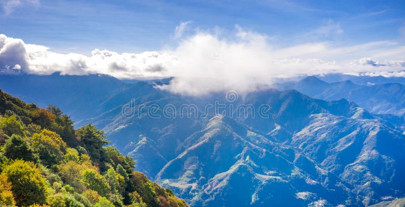 Flying drone towards beautiful amazing famous Mt. Hehuan in Taiwan over above the hilltop, aerial view shot royalty free stock photo