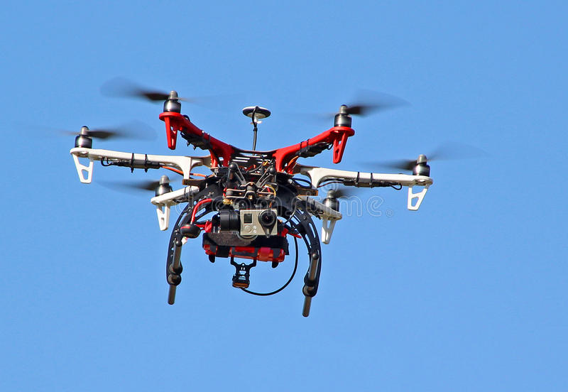 Flying drone video camera spy royalty free stock images