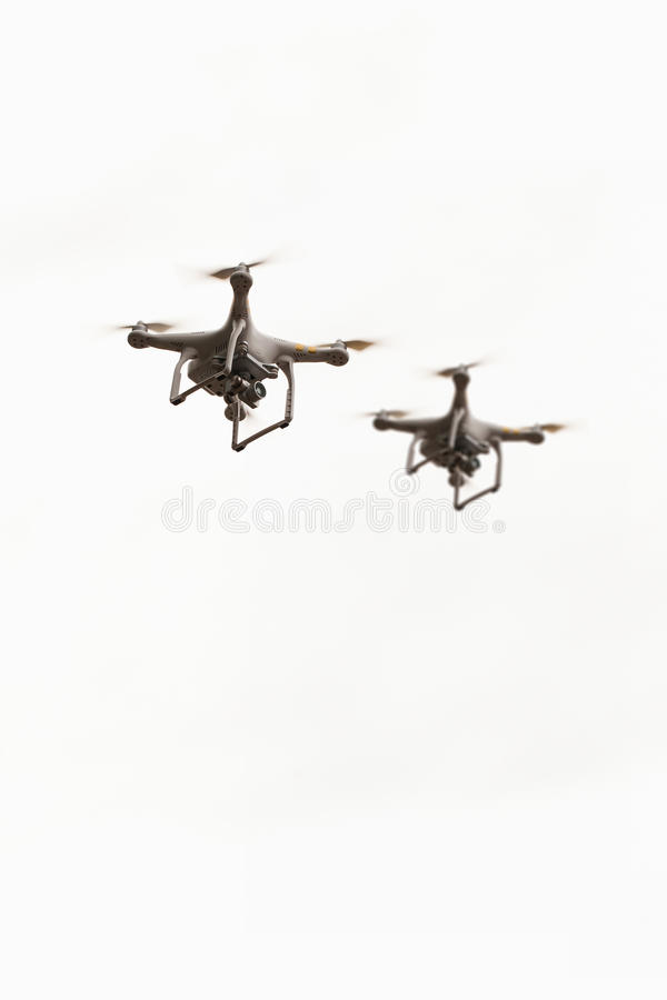 Flying drones with camera, quadcopters on white stock images
