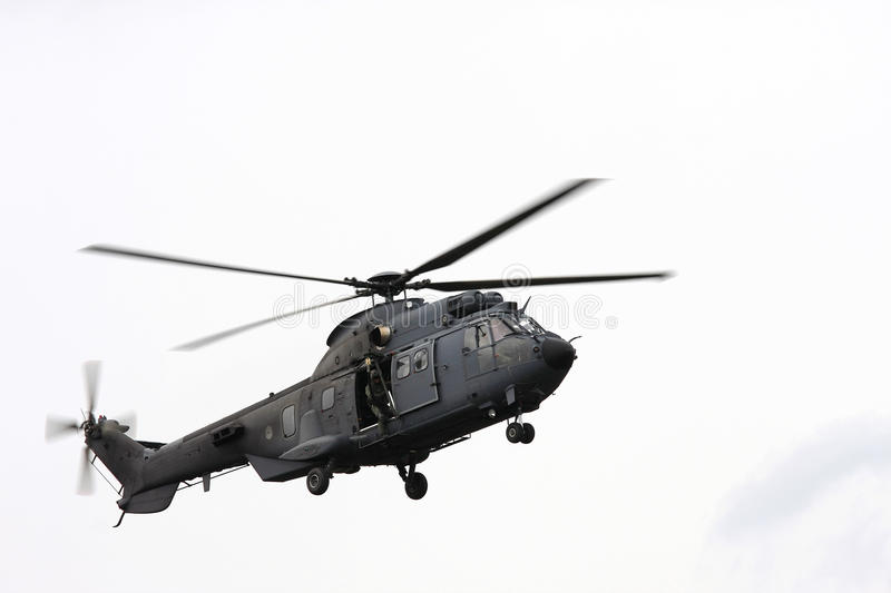 Flying dutch air force helicopter. The royal netherlands air force has eurocopters AS532U2 Cougar for transport of troops and equipment stock photos