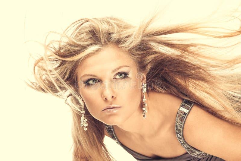Flying fair hair stock photography