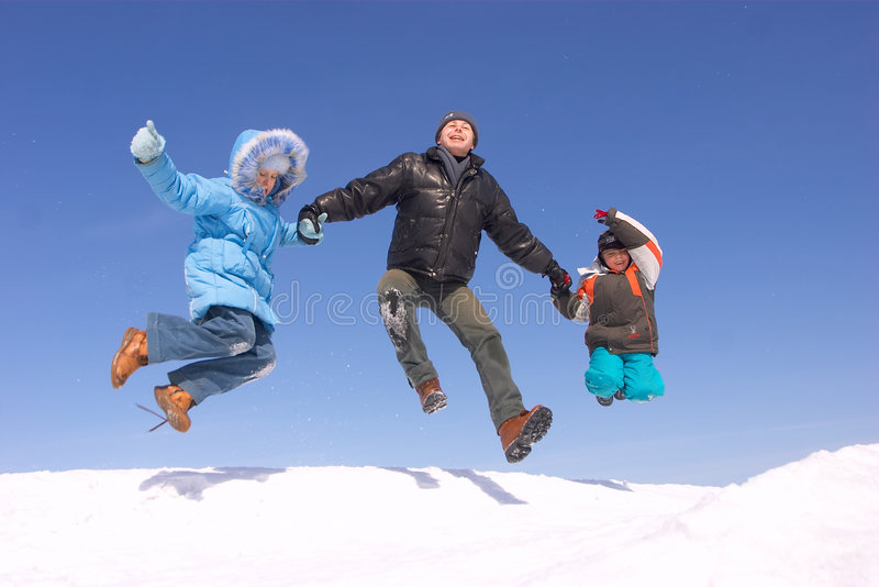 Flying family. Father son and daughter jumping