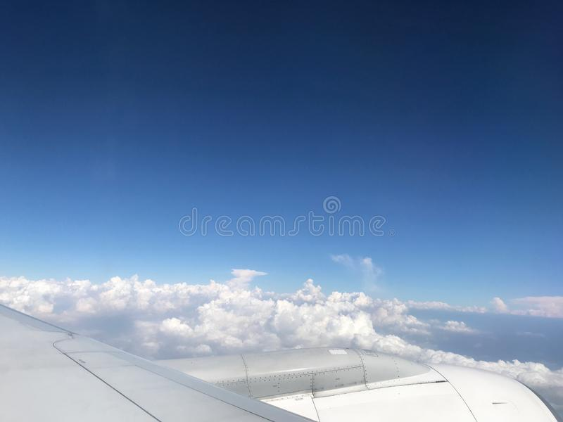 Flying flight outside window cloudy blue sky royalty free stock photos