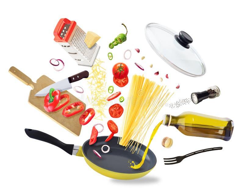 Flying food ingredients falling into frying pan royalty free stock image