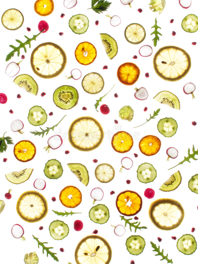 Flying fresh greens and fruits, cucumber, rucola,cucumber, lemon, brussel sprouts, parsley, royalty free stock image