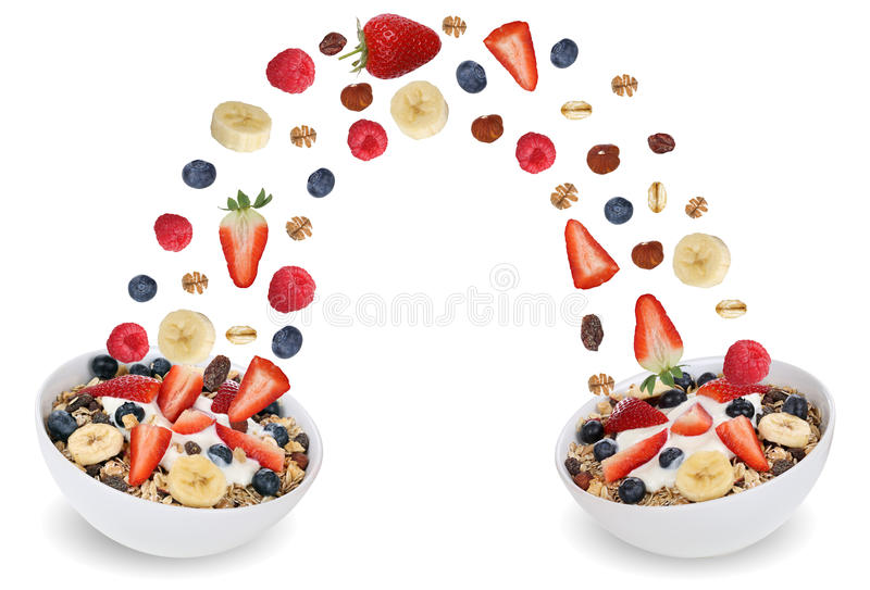 Flying fruit muesli for breakfast in bowl with fruits like banana and strawberry royalty free stock images