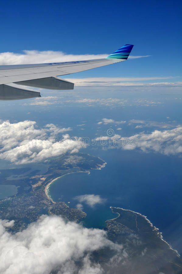 Flying Garuda Airlines over South Sydney, Australia royalty free stock image