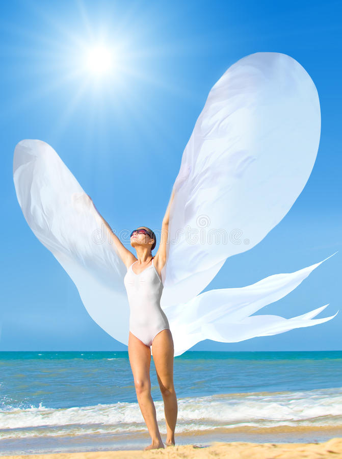 Flying goddess of summer stock photos