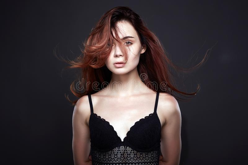 Girl in black underwear. Healthy Red Hair. Flying hair Pretty Girl in black underwear. Healthy Red Hair Beautiful Young Woman stock image