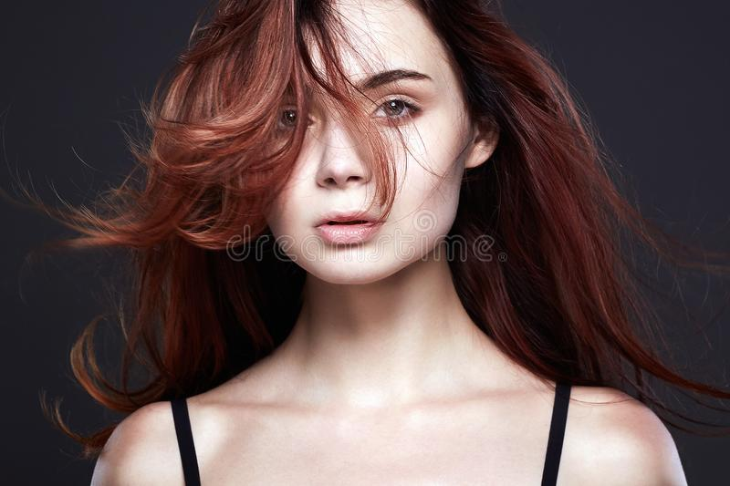 Healthy Red Hair Beautiful Young Woman. Flying hair Pretty Girl. Healthy Red Hair Beautiful Young Woman stock photo