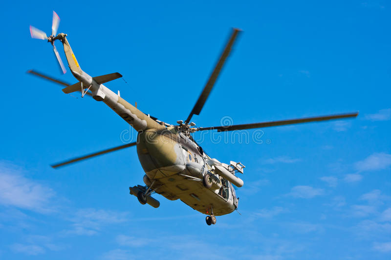 Flying helicopter stock image