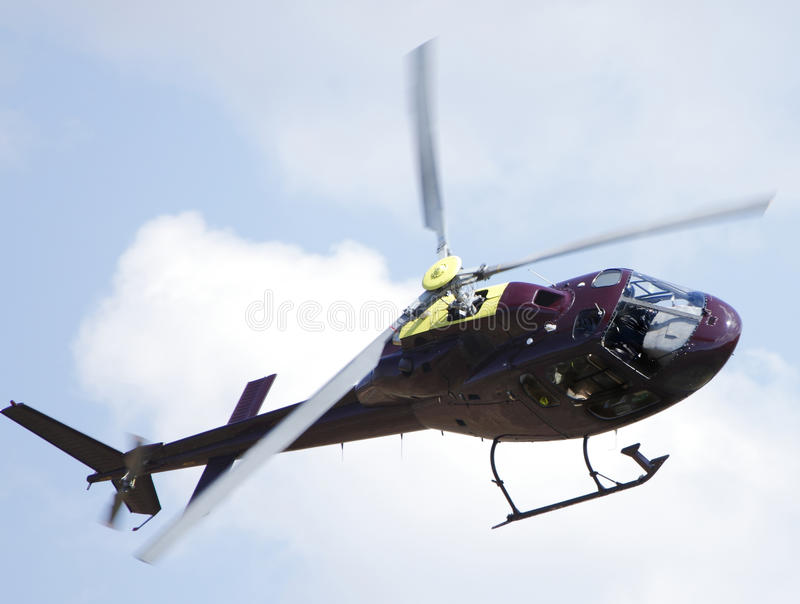 Flying helicopter stock images