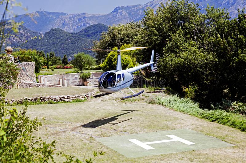 A flying helicopter bringing tourists to a luxury beautiful hotel in Ravello, Italy royalty free stock image