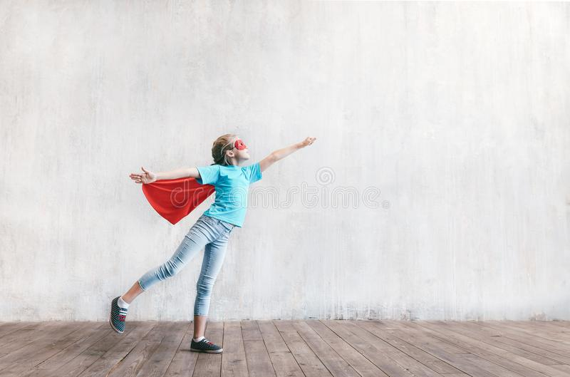 Flying hero in studio. Flying little hero in studio royalty free stock photography