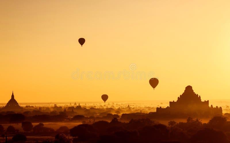 Flying hot air ballons during sunrise at Bagan, Myanmar royalty free stock images