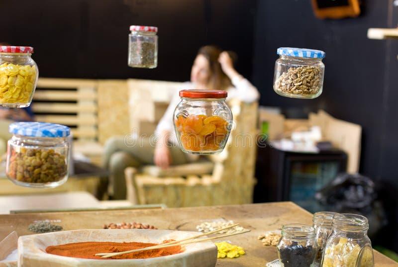 Flying jars. Girls dieting nightmare of flying jars with healthy food stock image
