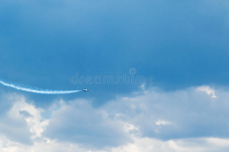 Flying jet plane in the blue sky stock photos
