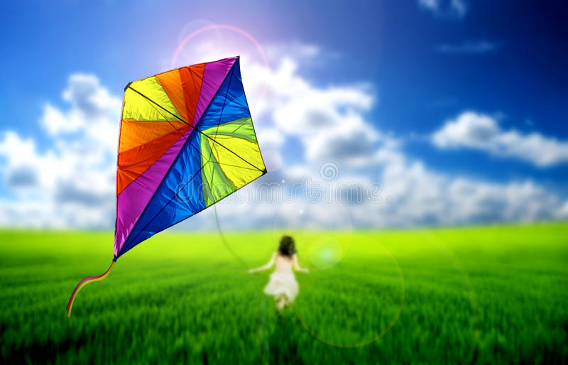 Flying kite. Kite flying across a meadow