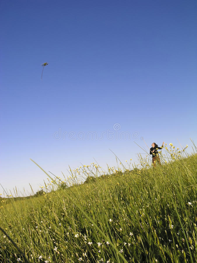 Flying a kite royalty free stock photo
