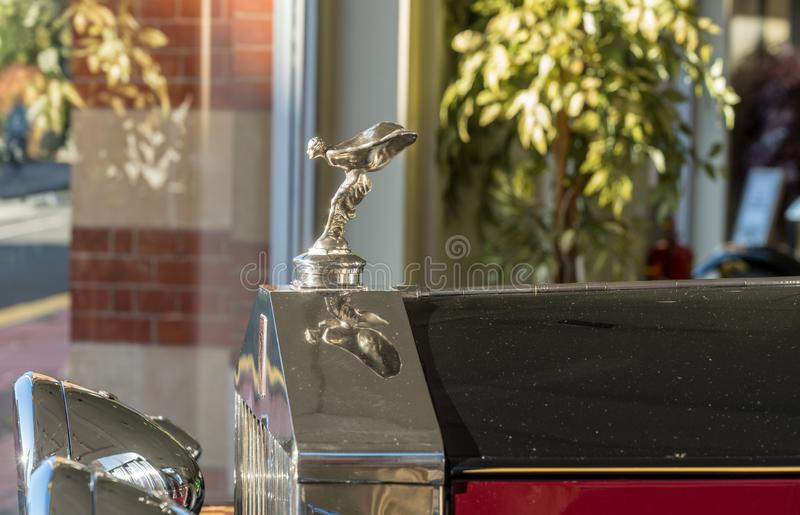Flying Lady mascot on old Rolls Royce car royalty free stock image