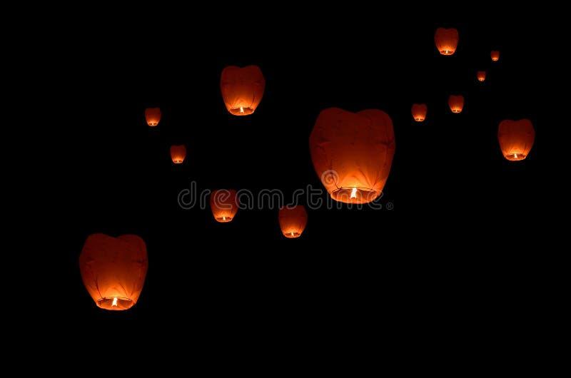 Flying lantern in the dark sky royalty free stock photo