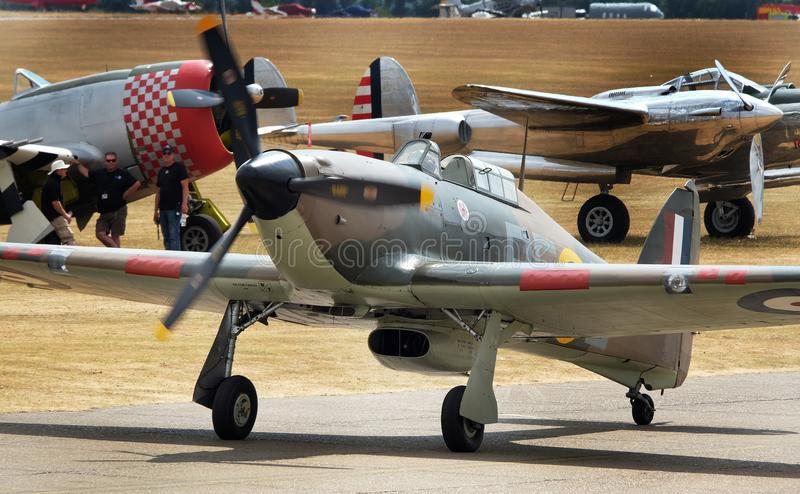 Hawker Hurricane is a British single-seat fighter aircraft of the 1930s–1940s . Flying Legends air show, Imperial War Museum, Duxford, Cambridgeshire. UK royalty free stock photo