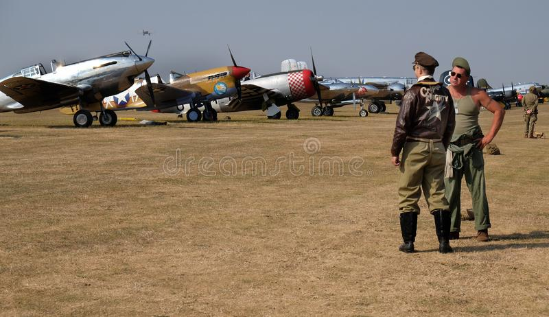 Two re-enactors dressed as pilot and ground crew. royalty free stock images