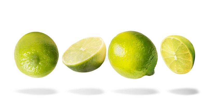 Flying lime with shadow, isolated on white background. Horizontal. Healthy food royalty free stock photos