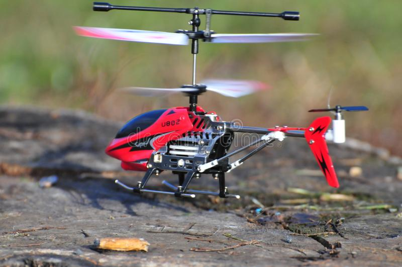 Flying little model of helicopter. Flying little electric model of helicopter. Outside royalty free stock images