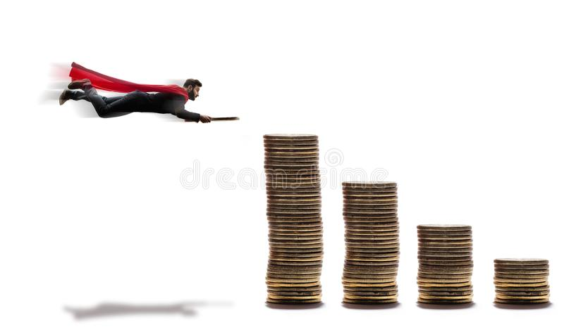 A flying man with a coin in his hands. stock photo