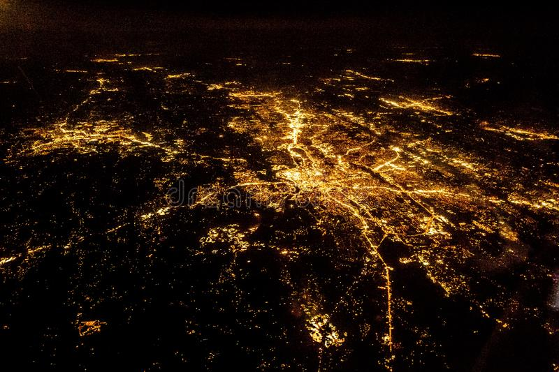 Flying at night over cities below royalty free stock photos