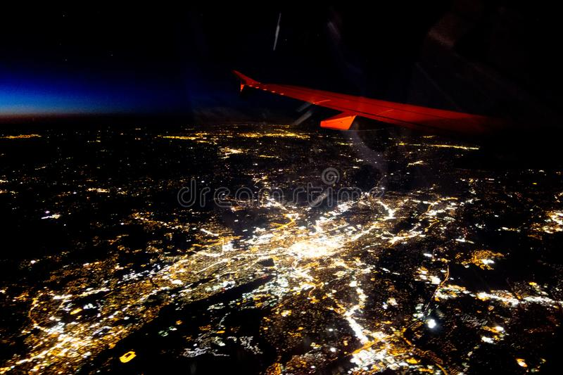 Flying at night over cities below stock images