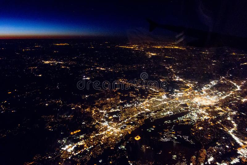 Flying at night over cities below royalty free stock images