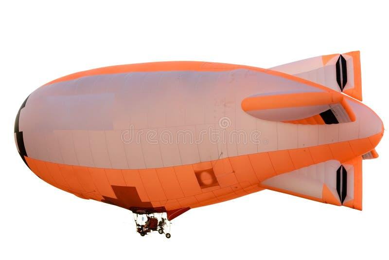 Flying orange blimp stock photo
